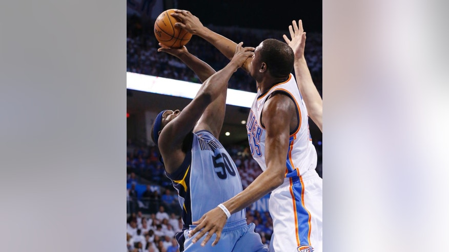 Oklahoma City Thunder forward Kevin Durant  blocks a shot by Memphis Grizzlies forward Zach Randolph (50) in the first quarter of Game 2 of an opening-round NBA basketball playoff series in Oklahoma City, Monday, April 21, 2014. (AP Photo/Sue Ogrocki)