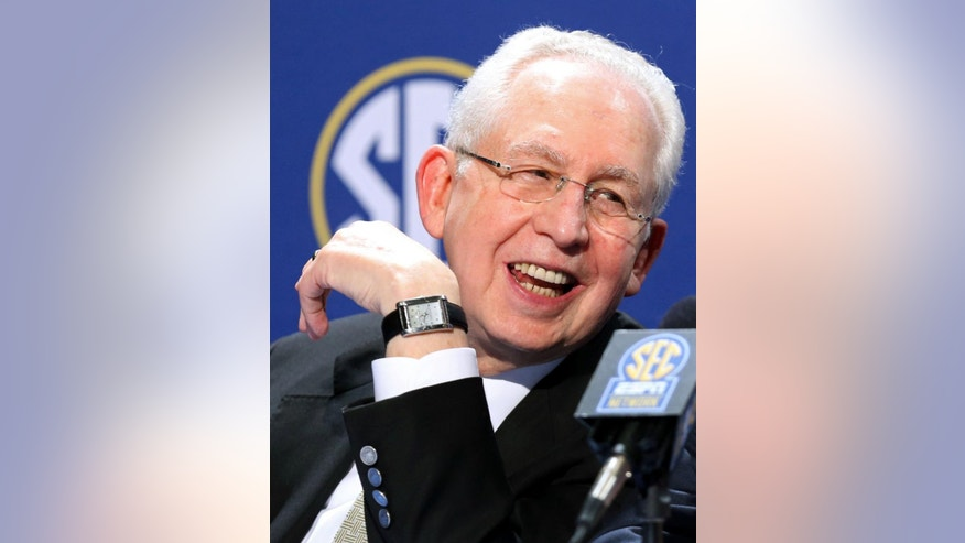 FILE - In this Dec. 6, 2013 file photo, Southeastern Conference Commissioner Mike Slive speaks during a press conference the day before the SEC Football Championship game at the Georgia Dome in Atlanta. Slive addresses an Associated Press Sports Editors meeting with athletes' unionization among the hot topics in college sports, Monday, April 21, 2014, in Birmingham, Ala. (AP Photo/Atlanta Journal-Constitution, Jason Getz, File)  MARIETTA DAILY OUT; GWINNETT DAILY POST OUT; LOCAL TV OUT; WXIA-TV OUT; WGCL-TV OUT