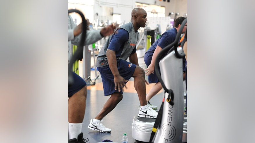 A photo provided by the Denver Broncos is of defensive end DeMarcus Ware working out during the first phase of the offseason training program at the NFL football teams training facility in Englewood, Colo., on Monday, April 21, 2014. (AP Photo/Eric Lars Bakke)