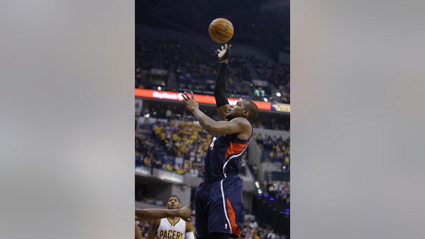 Atlanta Hawks' Paul Millsap puts up a shot during the first half in Game 2 of an opening-round NBA basketball playoff series against the Indiana Pacers Tuesday, April 22, 2014, in Indianapolis. (AP Photo/Darron Cummings)