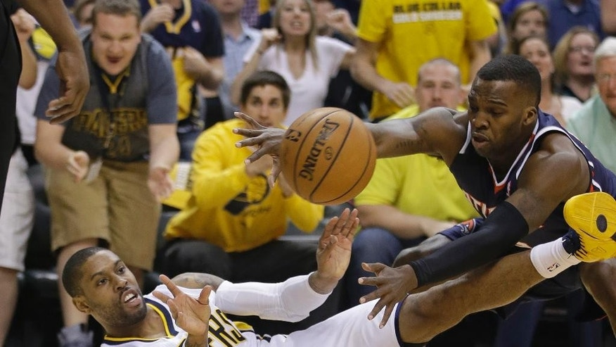 Indiana Pacers' C.J. Watson makes a pass while being defended  by Atlanta Hawks' Shelvin Mack during the first half in Game 2 of an opening-round NBA basketball playoff series Tuesday, April 22, 2014, in Indianapolis. (AP Photo/Darron Cummings)
