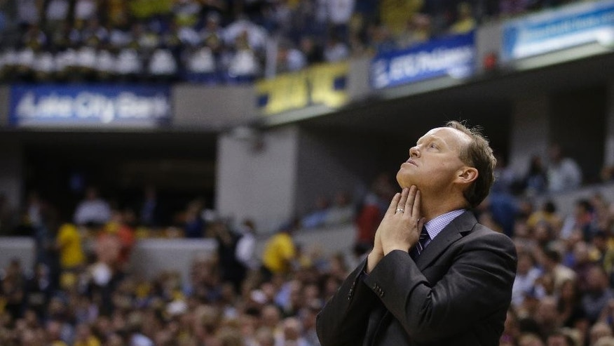 Atlanta Hawks head coach Mike Budenholzer looks up at the scoreboard during the second half in Game 2 of an opening-round NBA basketball playoff series against the Indiana Pacers Tuesday, April 22, 2014, in Indianapolis. Indiana defeated Atlanta 101-85. (AP Photo/Darron Cummings)