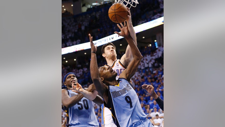 Oklahoma City Thunder forward Nick Collison (4) and Memphis Grizzlies guard Tony Allen (9) reach for a rebound in front of forward Zach Randolph (50) in overtime of Game 2 of an opening-round NBA basketball playoff series in Oklahoma City, Monday, April 21, 2014. Memphis won 111-105 in overtime. (AP Photo/Sue Ogrocki)