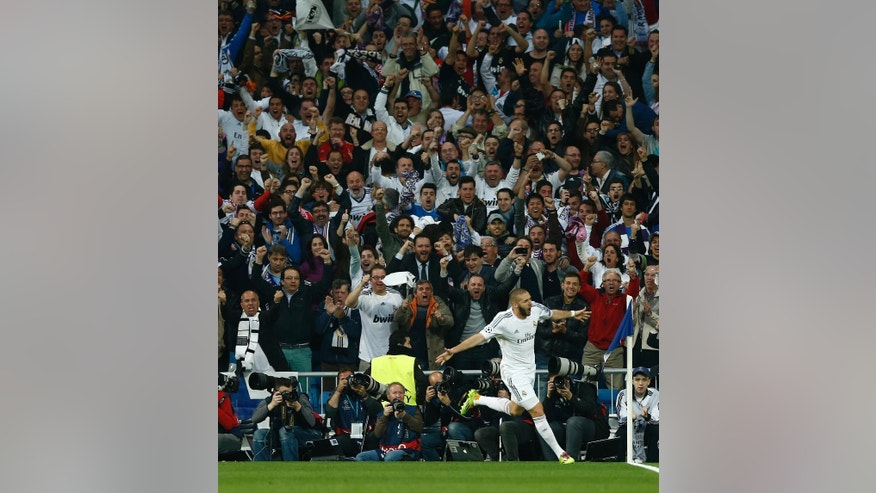 Real's Karim Benzema celebrates after scoring his side's first goal during a first leg semifinal Champions League soccer match between Real Madrid and Bayern Munich at the Santiago Bernabeu stadium in Madrid, Spain, Wednesday, April 23, 2014. (AP Photo/Andres Kudacki)