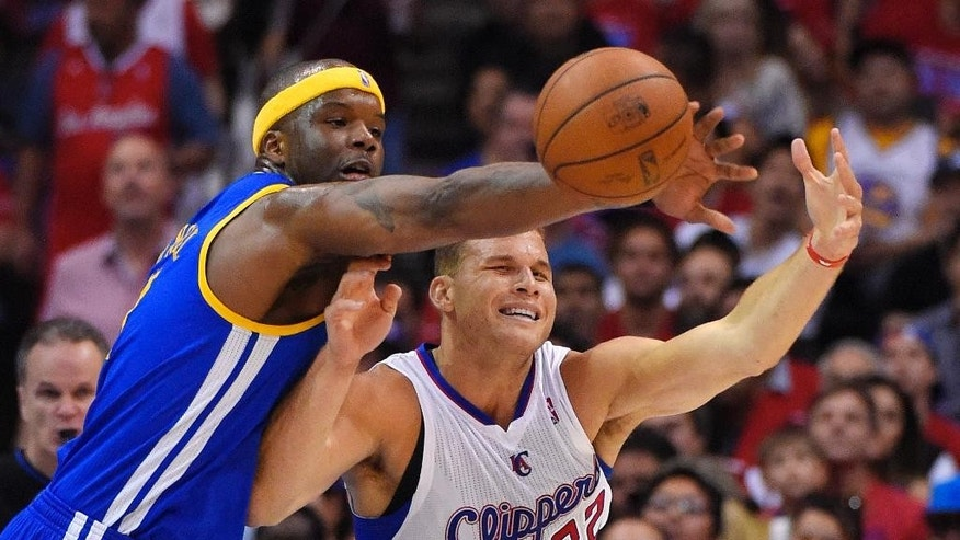 Golden State Warriors center Jermaine O'Neal, left, blocks a pass meant for Los Angeles Clippers forward Blake Griffin during the second half in Game 1 of an opening-round NBA basketball playoff series, Saturday, April 19, 2014, in Los Angeles. The Warriors won 109-105. (AP Photo/Mark J. Terrill)