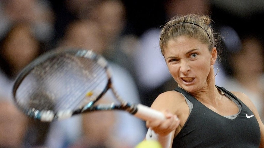 Sara Errani of Italy returns the ball to Russia's Maria Sharapova during their semifinal match at the Porsche tennis Grand Prix in Stuttgart, Germany, Saturday, April 26, 2014. Sharapova won the match with 6-1 and 6-2. (AP Photo/dpa, Bernd Weissbrod)