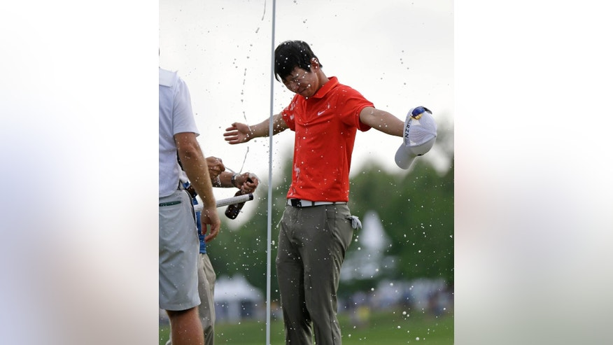Noh Seung-yul, of South Korea, is doused with beer on the 18th green after winning the Zurich Classic golf tournament at TPC Louisiana in Avondale, La., Sunday, April 27, 2014. (AP Photo/Bill Haber)