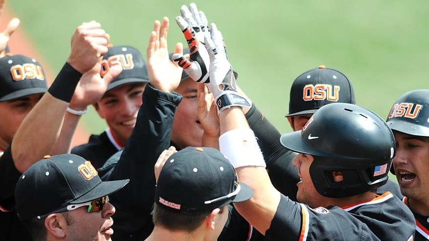 Oregon State's Michael Conforto celebrates a first-inning home run with teammates during an NCAA college baseball game on Sunday, April 27, 2014, in Corvallis, Ore. (AP Photo/Corvallis Gazette-Times, Jesse Skoubo) NO SALES; MAGAZINES OUT