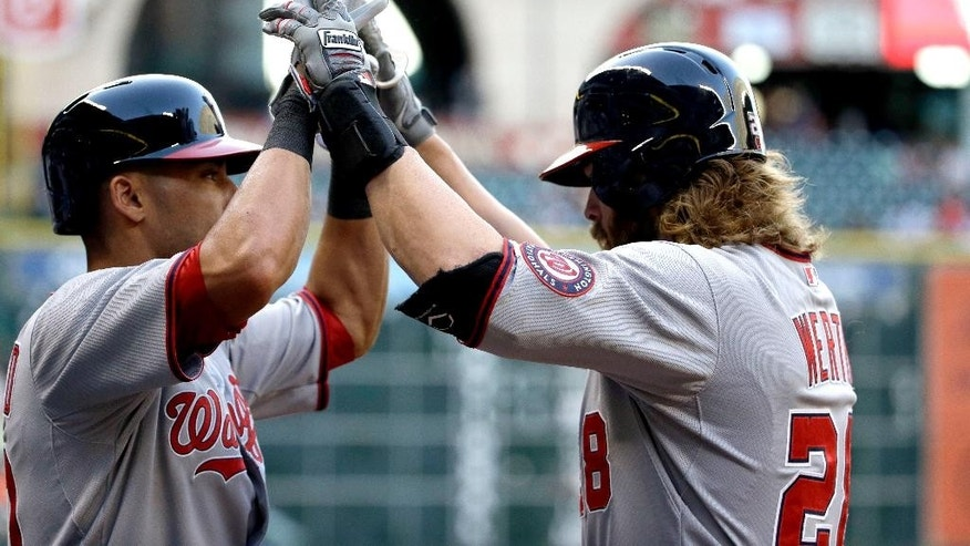 Washington Nationals' Jayson Werth, right, is congratulated by Ian Desmond after hitting a home run against the Houston Astros during the first inning of a baseball game Tuesday, April 29, 2014, in Houston. (AP Photo/David J. Phillip)