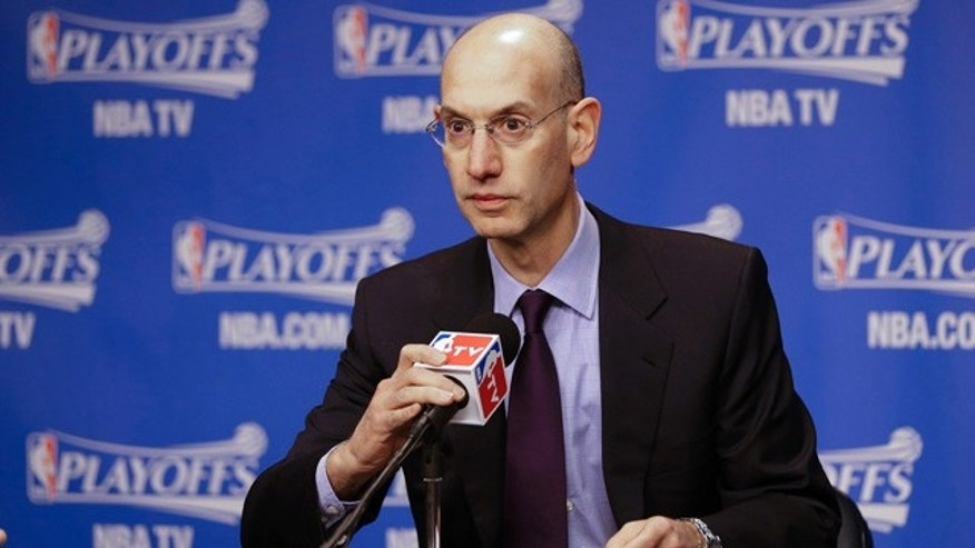 April 26, 2014: NBA Commissioner Adam Silver listens during a news conference before Game 4 of an opening-round NBA basketball playoff series between the Memphis Grizzlies and the Oklahoma City Thunder. (AP Photo/Mark Humphrey)