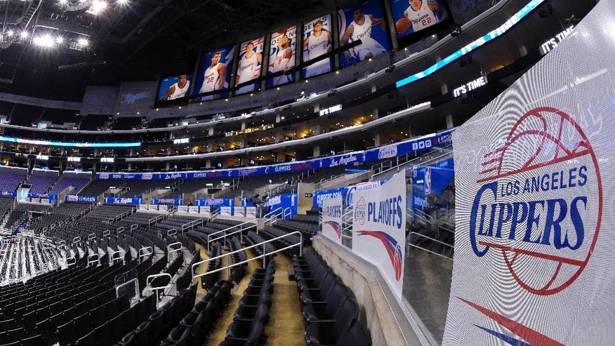 Signs and photos adorn Staples Center before Game 5 of an opening-round NBA basketball playoff series between the Los Angeles Clippers and the Golden State Warriors, Tuesday, April 29, 2014, in Los Angeles. (AP Photo)