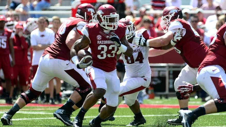ADDS ADDITIONAL INFORMATION - Arkansas running back Korliss Marshall (33) runs the ball during their spring NCAA college football game, Saturday, April 26, 2014, in Fayetteville, Ark. Marshall ran for 99 yards and two touchdowns on six carries to highlight Arkansas' Red-White Game. The predominately first-team Red won 61-22 over the White. (AP Photo/Sarah Bentham)