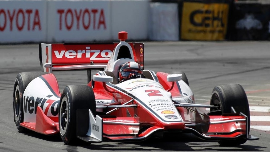 In this April 13, 2014, photo, Juan Pablo Montoya, of Colombia, drives through a turn in the IndyCar Grand Prix of Long Beach auto race in Long Beach, Calif. Montoya wants a strong encore after his fourth-place finish at Long Beach--his best in a test, practice or qualifying since jumping from NASCAR to IndyCar. (AP Photo/Alex Gallardo)