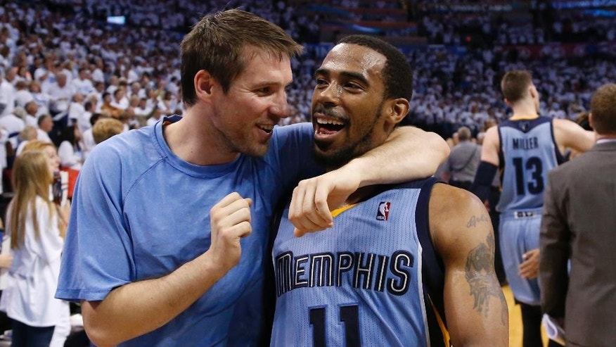 Memphis Grizzlies guard Beno Udrih, left, and guard Mike Conley (11) walk off the court after Game 5 of an opening-round NBA basketball playoff series against the Oklahoma City Thunder in Oklahoma City, Tuesday, April 29, 2014. Memphis won 100-99 in overtime, and lead the series 3-2. (AP Photo)