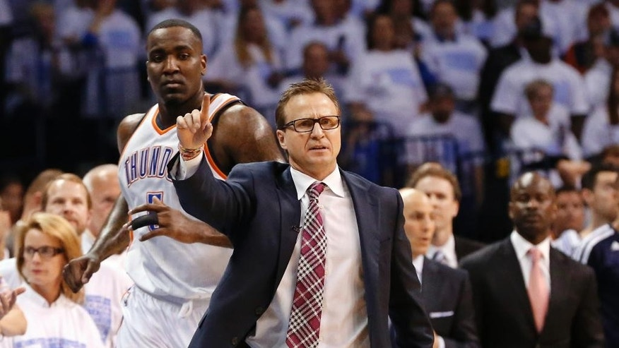 Oklahoma City Thunder coach Scott Brooks gestures from the sidelines in overtime of Game 5 of an opening-round NBA basketball playoff series against the Memphis Grizzlies in Oklahoma City, Tuesday, April 29, 2014. Thunder center Kendrick Perkins is at left. Memphis won 100-99. (AP Photo)
