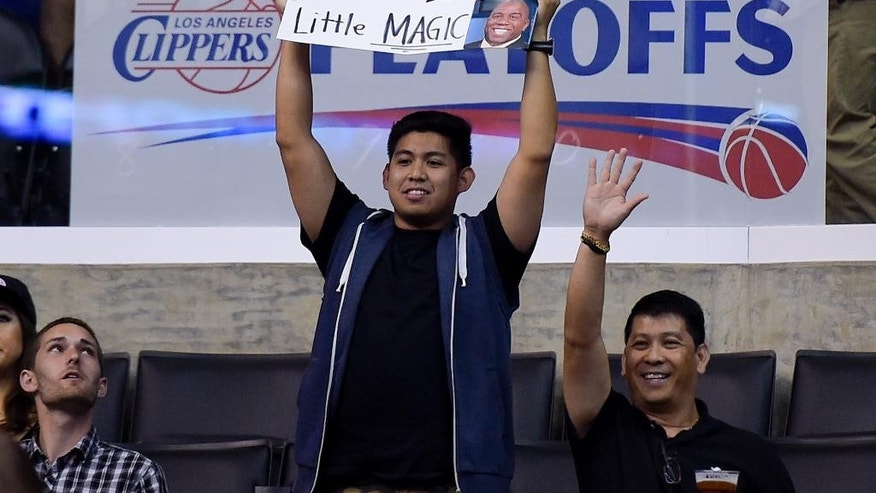 Fans hold up signs in support of the Los Angeles Clippers before Game 5 of an opening-round NBA basketball playoff series between the Clippers and the Golden State Warriors on Tuesday, April 29, 2014, in Los Angeles. NBA Commissioner Adam Silver announced Tuesday that Los Angeles Clippers owner Donald Sterling has been banned for life by the league for making racist comments that hurt the league. (AP Photo)
