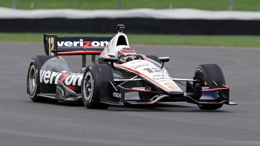 Will Power, of Australia, takes a turn during testing for the inaugural Grand Prix of Indianapolis auto race on the new road course at Indianapolis Motor Speedway in Indianapolis, Wednesday, April 30, 2014. (AP Photo/Michael Conroy)