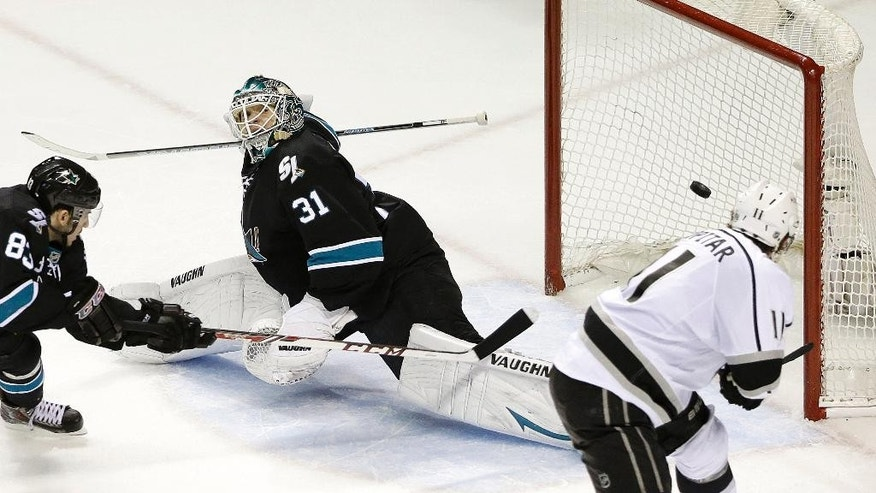 Los Angeles Kings center Anze Kopitar, of Yugoslavia, right, scores a goal past San Jose Sharks goalie Antti Niemi (31), of Finland, and left wing Matt Nieto (83) during the second period of Game 7 of an NHL hockey first-round playoff series in San Jose, Calif., Wednesday, April 30, 2014. (AP Photo)