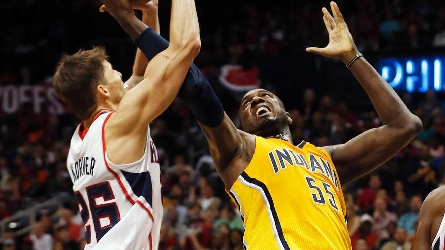 Atlanta Hawks guard Kyle Korver, left, and Indiana Pacers center Roy Hibbert (55) battle for the rebound in the first half of Game 4 of an NBA basketball first-round playoff series, Saturday, April 26, 2014, in Atlanta. (AP Photo/John Bazemore)