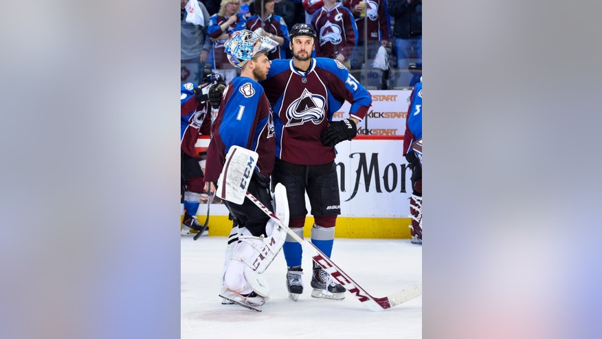 Colorado Avalanche goalie Semyon Varlamov (1) of Russia and Patrick Bordeleau (58) stand following the team's 5-4 overtime loss to the  Minnesota Wild  following Game 7 of an NHL hockey first-round playoff series on Wednesday, April 30, 2014, in Denver. Minnesota won 5-4 to win the series.  (AP Photo/Jack Dempsey)