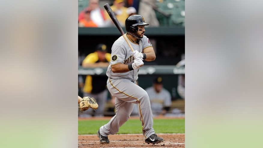 Pittsburgh Pirates' Pedro Alvarez hits an RBI-single in the third inning of the first baseball game of a doubleheader against the Baltimore Orioles, Thursday, May 1, 2014, in Baltimore. Pirates' Jose Tabata scored on the play. (AP Photo/Patrick Semansky)