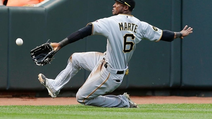 Pittsburgh Pirates left fielder Starling Marte reaches but can't catch Baltimore Orioles' Steve Clevenger's fly ball in the second inning in the first baseball game of a doubleheader, Thursday, May 1, 2014, in Baltimore. Clevenger doubled on the play. (AP Photo/Patrick Semansky)