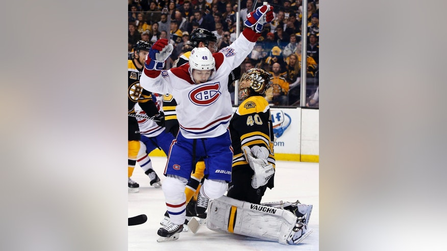 Montreal Canadiens center Daniel Briere (48) celebrates a goal by teammate P.K. Subban against Boston Bruins goalie Tuukka Rask (40) during the first period in Game 1 of an NHL hockey second-round playoff series in Boston, Thursday, May 1, 2014. (AP Photo/Elise Amendola)
