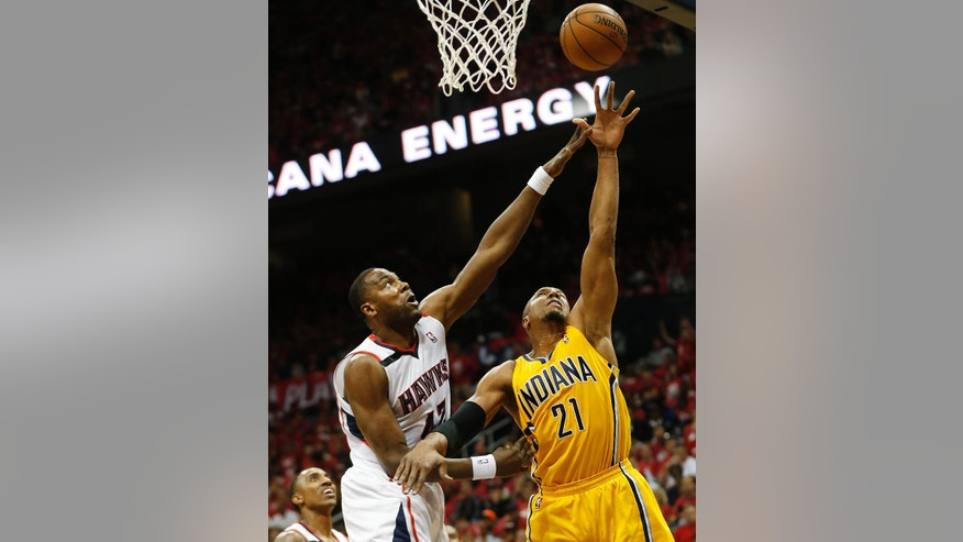 Indiana Pacers forward David West (21) shoots as Atlanta Hawks forward Elton Brand (42) defends in the first half of Game 6 of a first-round NBA basketball playoff series in Atlanta, Thursday, May 1, 2014. (AP Photo/John Bazemore)