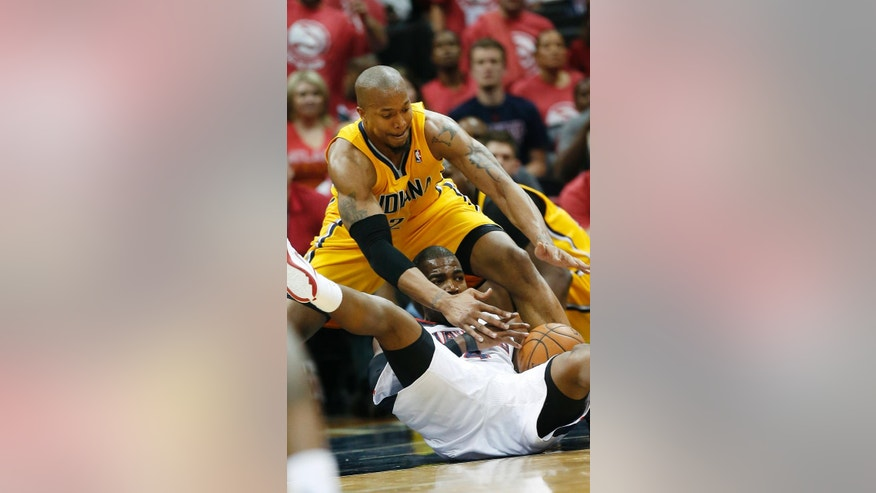Atlanta Hawks forward Paul Millsap, bottom, and Indiana Pacers forward David West, top, battle for a loose ball in the first half of Game 6 of a first-round NBA basketball playoff series in Atlanta, Thursday, May 1, 2014. (AP Photo/John Bazemore)