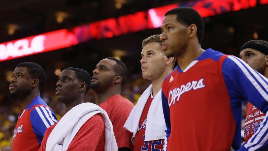 Members of the Los Angeles Clippers watch from the bench in the closing seconds of a loss to the Golden State Warriors during Game 6 of an opening-round NBA basketball playoff series on Thursday, May 1, 2014, in Oakland, Calif. Golden State won 100-99. (AP Photo/Marcio Jose Sanchez)