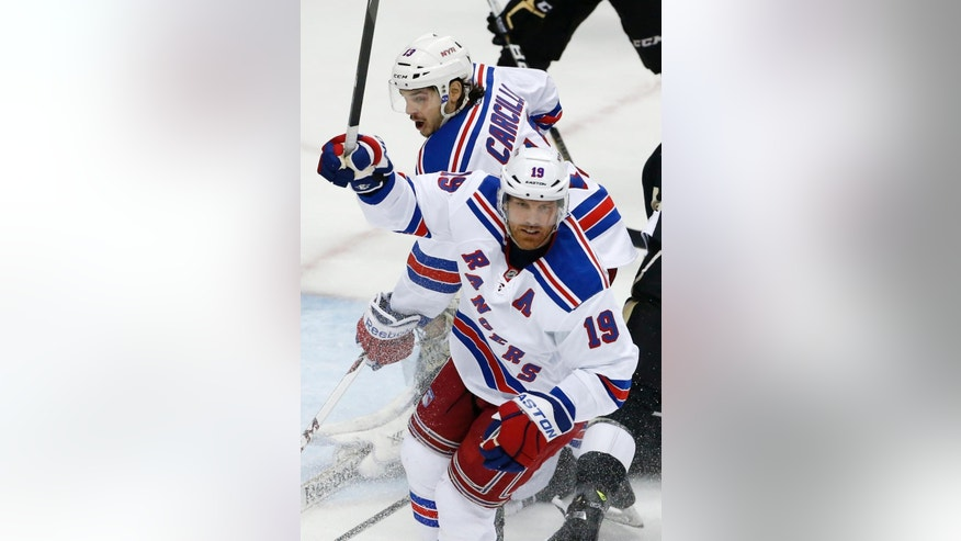 New York Rangers' Brad Richards (19) celebrates his goal in the first period of Game 1 of a second-round NHL hockey playoff series against the Pittsburgh Penguins in Pittsburgh, Friday, May 2, 2014. (AP Photo/Gene J. Puskar)