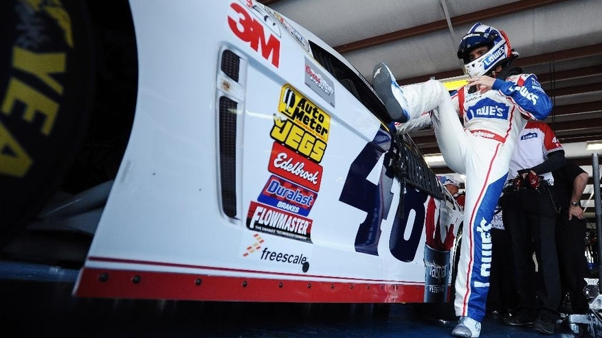 Driver Jimmie Johnson climbs into his car before practice for Sunday's Aaron's 499 NASCAR auto race at Talladega Superspeedway on Friday, May 2, 2014, in Talladega, Ala. (AP Photo/Rainier Ehrhardt)