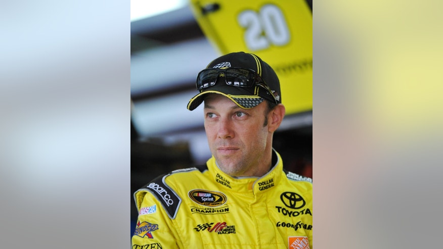 Driver Matt Kenseth stands in the garage area before practice for Sunday's Aaron's 499 NASCAR auto race at Talladega Superspeedway on Friday, May 2, 2014, in Talladega, Ala. (AP Photo/Rainier Ehrhardt)