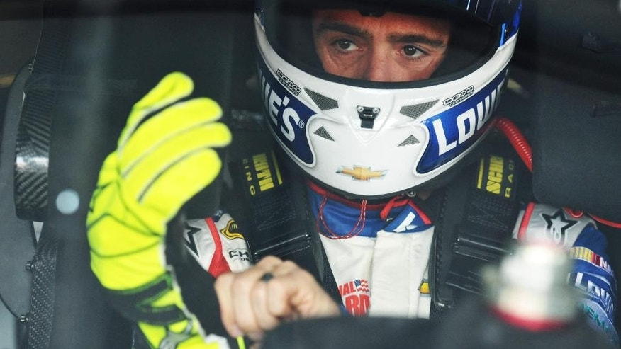Driver Jimmie Johnson sits in his car during practice for Sunday's Aaron's 499 NASCAR auto race at Talladega Superspeedway on Friday, May 2, 2014, in Talladega, Ala. (AP Photo/Rainier Ehrhardt)