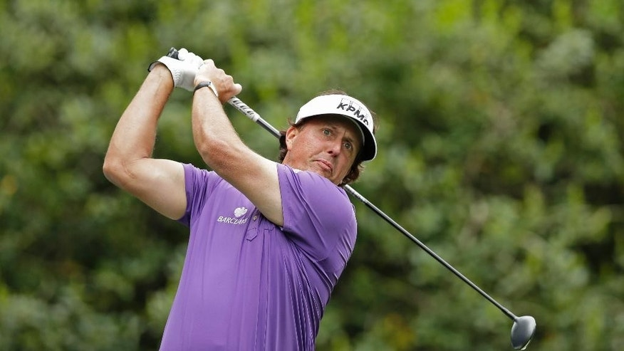 Phil Mickelson watches his tee shot on the 14th hole during the second round of the Wells Fargo Championship golf tournament in Charlotte, N.C., Friday, May 2, 2014. (AP Photo/Chuck Burton)