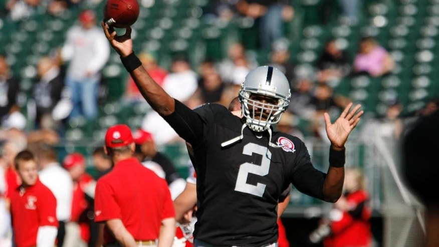 ADVANCE FOR USE WEEKEND, MAY 3-4 - FILE - In this Nov. 15, 2009, file photo, Oakland Raiders' JaMarcus Russell throws before an NFL football game in Oakland, Calif. Russell was taken by Oakland Raiders first overall out of LSU in 2007. After a 7-18 record as a starter, with 23 interceptions and only 18 touchdowns on his resume, Russell was overweight and out of the league three years later. (AP Photo/Ben Margot, File)