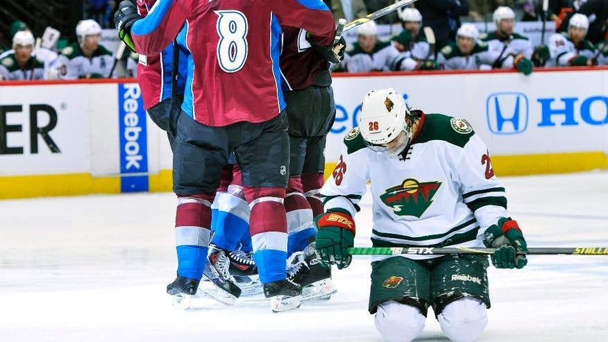 Minnesota Wild left wing Matt Moulson (26) hangs his head as members of the Colorado Avalanche celebrate a Paul Stastny goal in the third period during Game 7 of an NHL hockey first-round playoff series on Wednesday, April 30, 2014, in Denver. (AP Photo/Jack Dempsey)