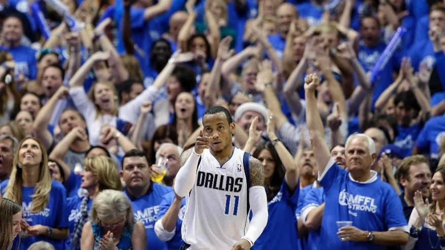 Fans cheer as Dallas Mavericks' Monta Ellis (11) celebrates after scoring and being fouled by the San Antonio Spurs in the second half of Game 6 of an NBA basketball first-round playoff series on Friday, May 2, 2014, in Dallas. The Mavericks won 113-111. (AP Photo/Tony Gutierrez)