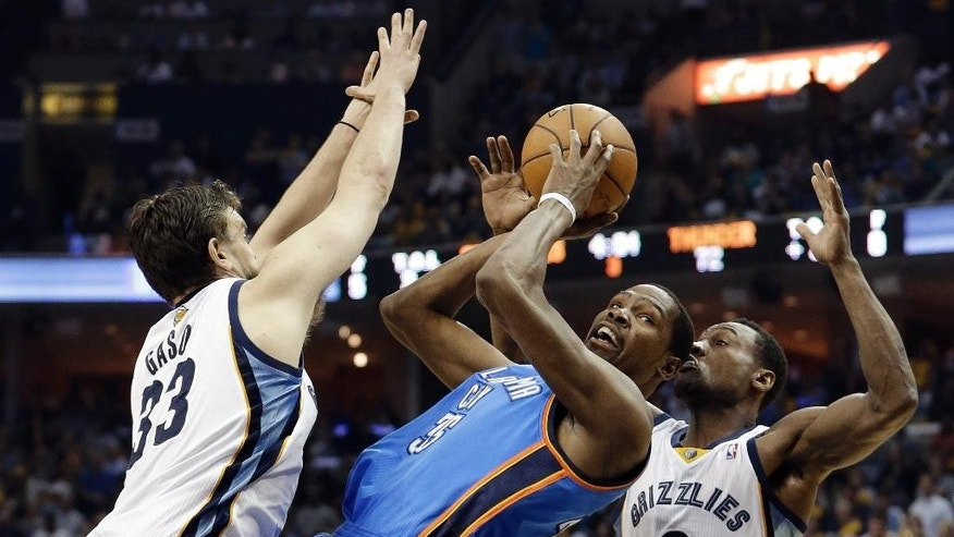 Oklahoma City Thunder forward Kevin Durant (35) shoots as he falls back between Memphis Grizzlies center Marc Gasol (33) and Tony Allen (9) in the second half of Game 6 of an opening-round NBA basketball playoff series Thursday, May 1, 2014, in Memphis, Tenn. Durant led Oklahoma City with 36 points as they won 104-84 to even the series 3-3. (AP Photo/Mark Humphrey)
