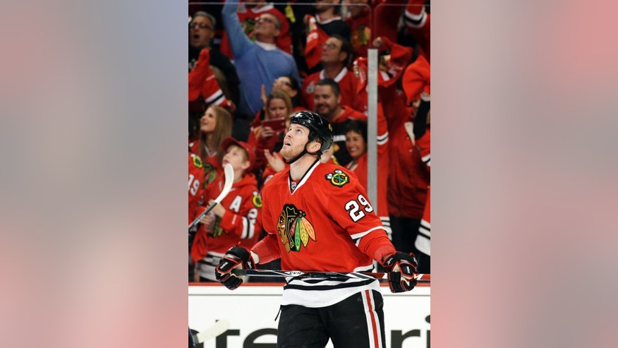 Chicago Blackhawks' Bryan Bickell (29) looks up at the scoreboard after scoring a goal during the first period in Game 1 of an NHL hockey second-round playoff series against the Minnesota Wild in Chicago, Friday, May 2, 2014. (AP Photo/Nam Y. Huh)