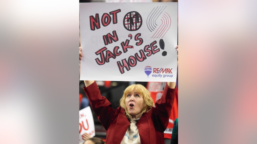 Portland Trail Blazers' fan Val Gaddy holds up a sign honoring former player and coach Jack Ramsay during the first half of game six of an NBA basketball first-round playoff series game in Portland, Ore., Friday May 2, 2014. (AP Photo/Greg Wahl-Stephens)