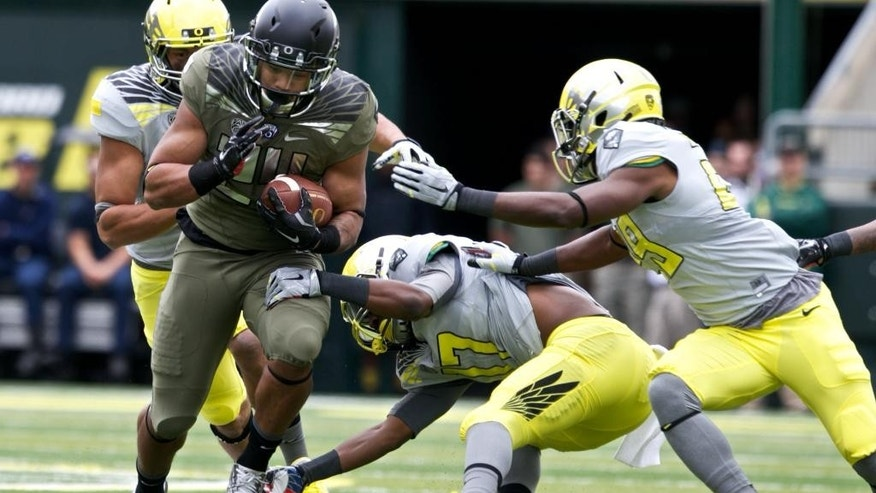Oregon's Thomas Tyner runs the ball during the Ducks spring NCAA college football game on Saturday, May 3, 2014, at Autzen Stadium in Eugene, Ore. (AP Photo/The Oregonian, Thomas Boyd)  MAGS OUT; TV OUT; LOCAL TV OUT; LOCAL INTERNET OUT; THE MERCURY OUT; WILLAMETTE WEEK OUT; PAMPLIN MEDIA GROUP OUT