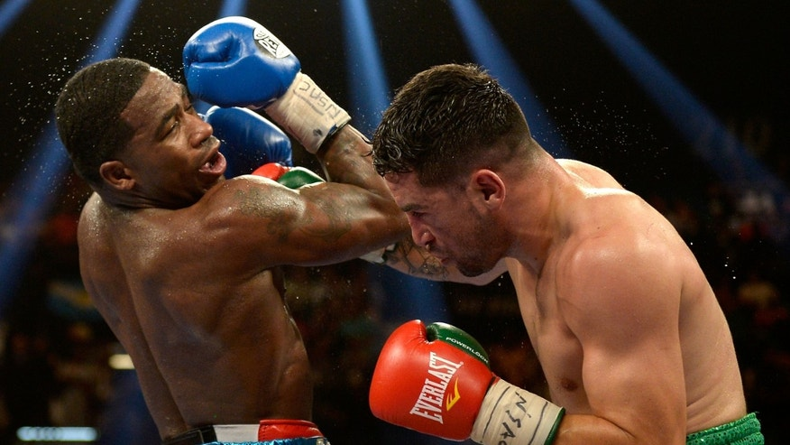 LAS VEGAS, NV - MAY 03:  Adrien Broner punches Carlos Molina during their super lightweight bout at the MGM Grand Garden Arena on May 3, 2014 in Las Vegas, Nevada. Broner won by unanimous decision.  (Photo by Harry How/Getty Images)