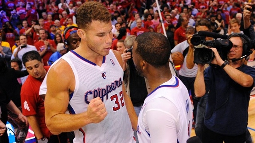 May 3, 2014: Los Angeles Clippers forward Blake Griffin, left, congratulates guard Chris Paul after defeating the Golden State Warriors in Game 7 of an opening-round NBA basketball playoff series in Los Angeles. The Clippers won 126-121. (AP Photo/Mark J. Terrill)