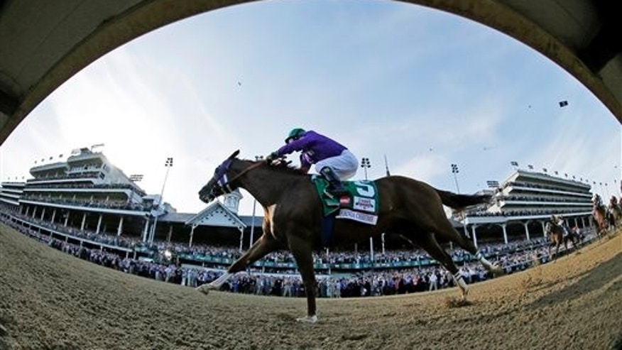 In this image taken with a fisheye lens, jockey Victor Espinoza rides California Chrome to win the 140th running of the Kentucky Derby horse race at Churchill Downs Saturday, May 3, 2014, in Louisville, Ky. (AP Photo/Matt Slocum)
