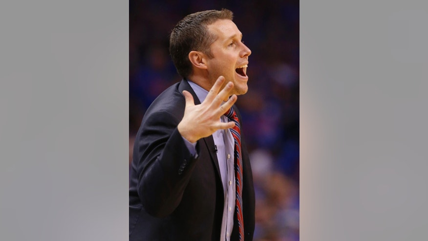 Memphis Grizzlies head coach David Joerger shouts in the third quarter of Game 7 of an opening-round NBA basketball playoff series against the Oklahoma City Thunder in Oklahoma City, Saturday, May 3, 2014. Oklahoma City won 120-109. (AP Photo/Sue Ogrocki)