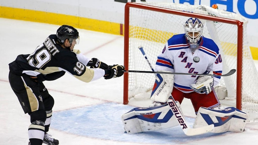 Pittsburgh Penguins' Beau Bennett (19) can't get his stick on a puck in front of New York Rangers goalie Henrik Lundqvist (30) in the first period of game 2 of a second-round NHL playoff hockey series in Pittsburgh Sunday, May 4, 2014. (AP Photo/Gene J. Puskar)