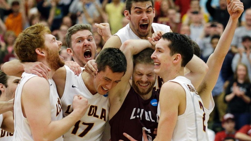 Loyola players celebrate after they defeated Stanford 3-1 in the NCAA men's college volleyball championship at Gentile Arena in Chicago on Saturday, May 3, 2014. (AP Photo/Nam Y. Huh)