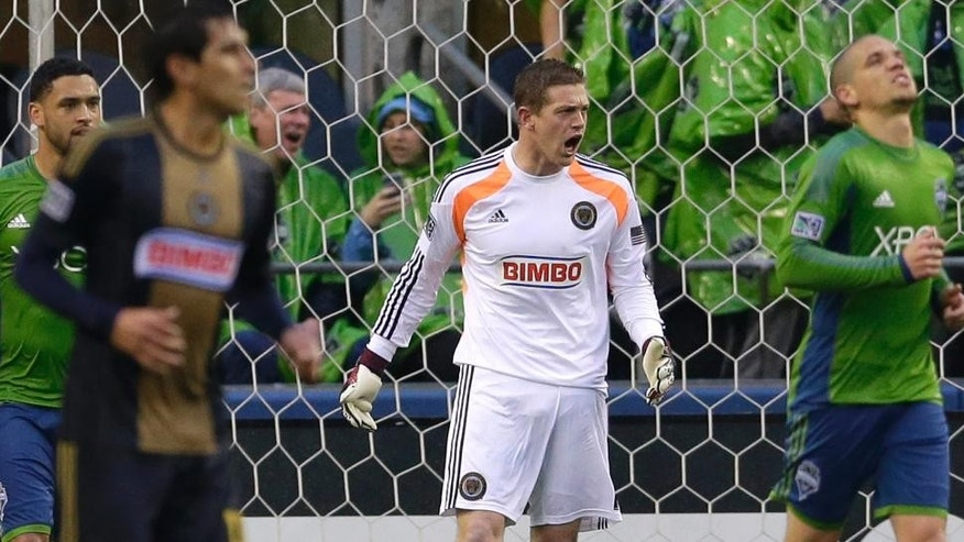 Philadelphia Union goalkeeper Zac MacMath, center, yells after saving a penalty attempt by Seattle Sounders' Osvaldo Alonso, right, in the first half of an MLS soccer match, Saturday, May 3, 2014, in Seattle. (AP Photo/Ted S. Warren)