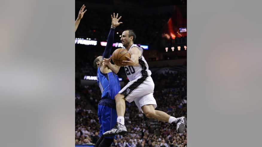 San Antonio Spurs' Manu Ginobili (20), of Argentina, drive around Dallas Mavericks' Monta Ellis (11) during the first half of Game 7 of the opening-round NBA basketball playoff series, Sunday, May 4, 2014, in San Antonio. (AP Photo/Eric Gay)